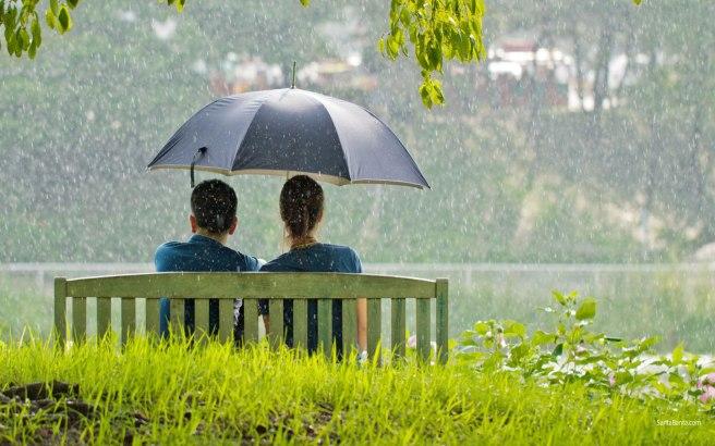 Romantic-couple-sitting-in-park-while-raining.jpg